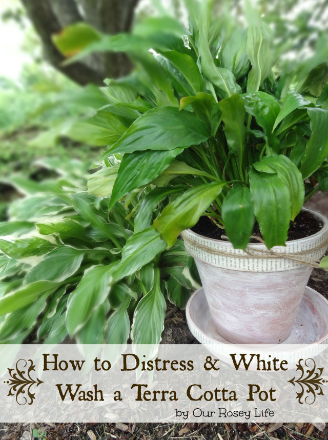 Distress-and-White-Wash-Terra-Cotta-Pots-with-Book-Page-Accent-by-Our-Rosey-Life